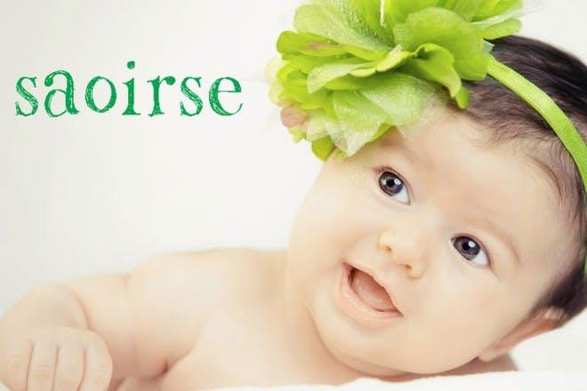 baby with green flower headband