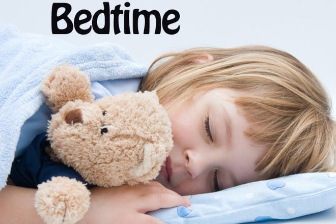 girl holding teddy and sleeping