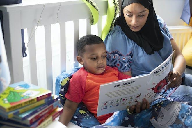 Mum reading to sick child