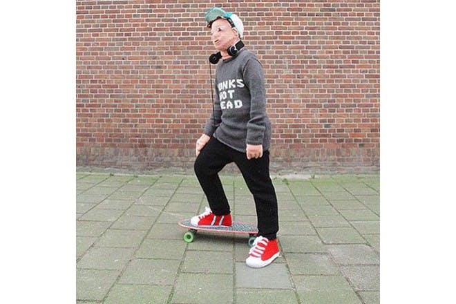 knitted son on skateboard