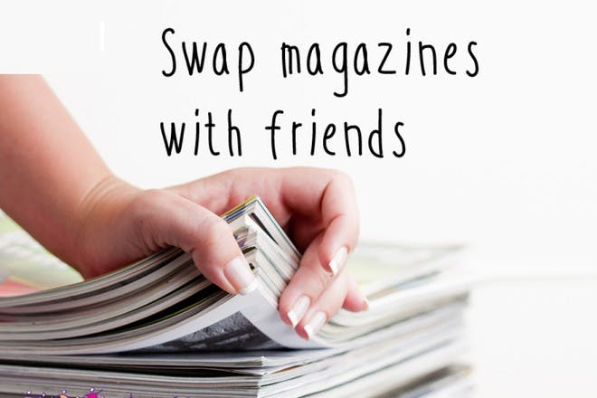 hand on stack of magazines