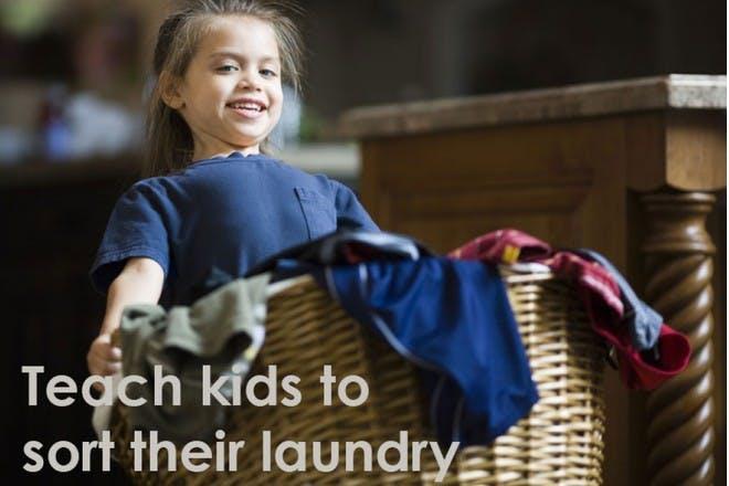 girl carrying washing basket