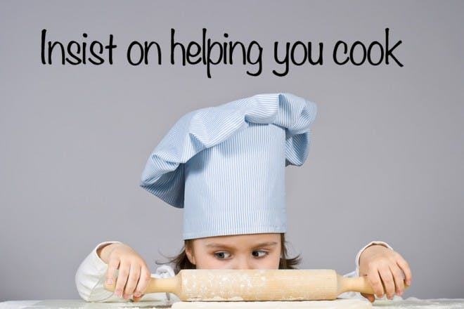 girl with chef hat and rolling pin