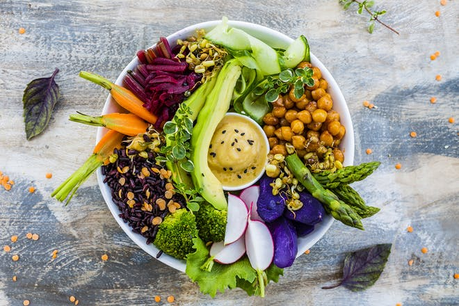 Chickpeas, lentils, sprouted seeds and veg in a bowl