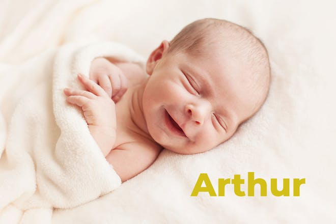 Baby smiling wrapped in towel. Name Arthur written in text
