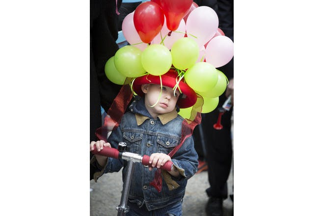 little boy in balloon hat at easter parade