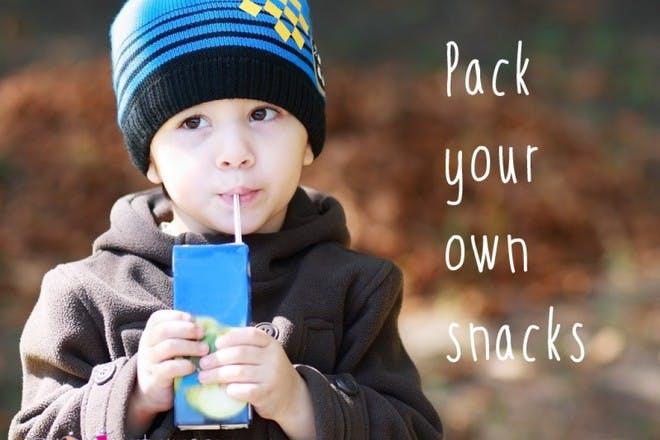boy drinking from juice box