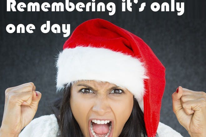 woman with christmas hat on screaming