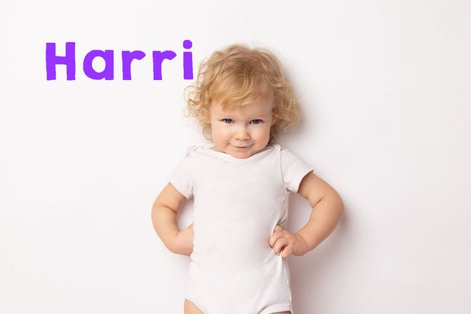 Toddler girl standing with hands on hips. Text says Harri