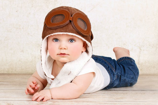 baby wearing flying hat