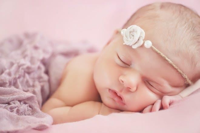 Baby girl sleeping white flower headband