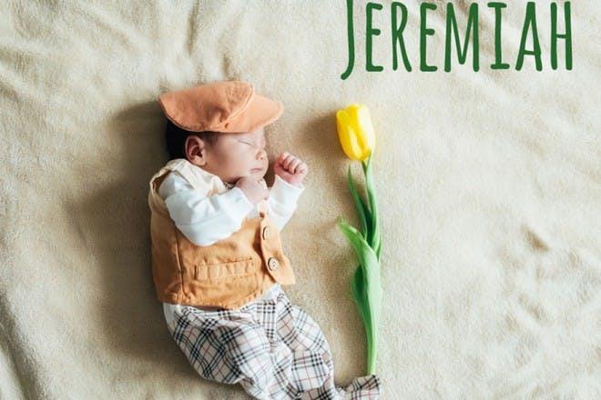 baby sleeping next to yellow flower