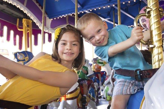 boy and girl on carousel