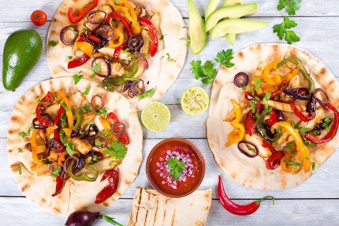 homemade chicken fajitas and salsa on a table
