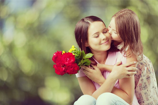 Mum and daughter holding flowers