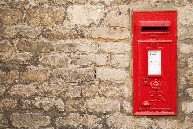 Red post box in wall