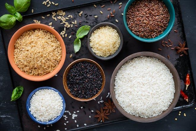 Six bowls of rice - red, black, basmati, whole grain, long grain and arborio.
