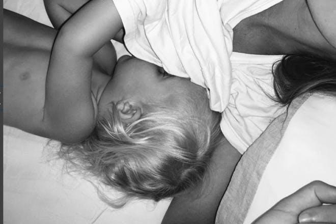 mum breastfeeding in bed