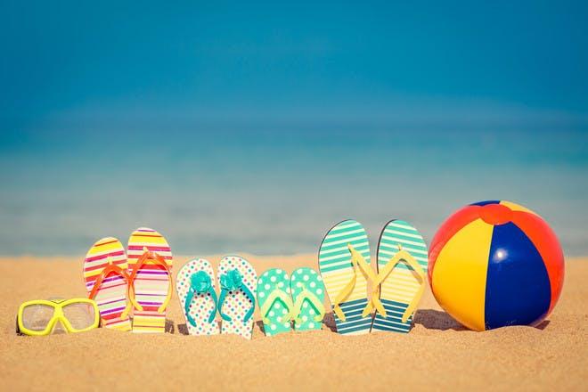 Family flip flops at the beach