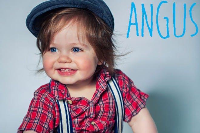 baby wearing red tartan shirt and blue cap