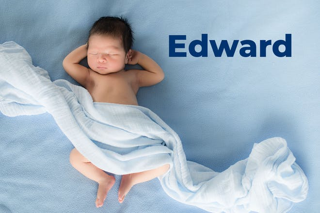 Baby lying on blue sheet covered in blue muslin. Name Edward written in text