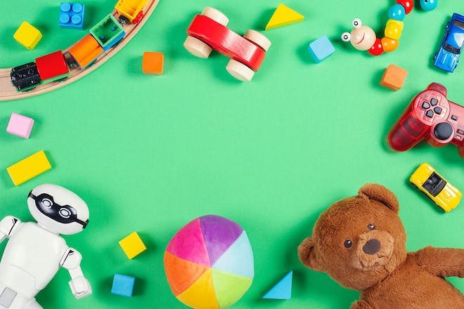 Selection of toys on green background