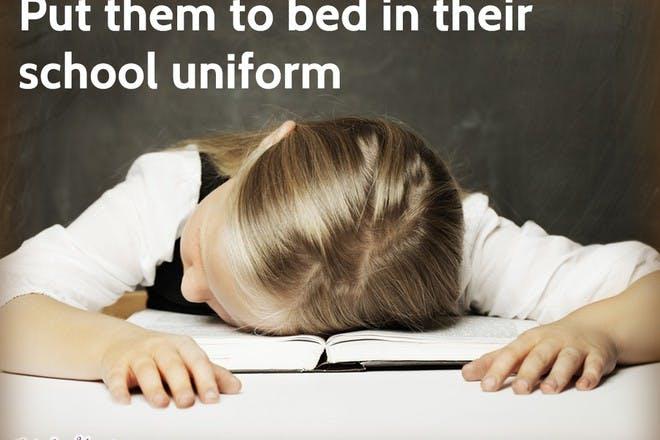 girl asleep on homework book