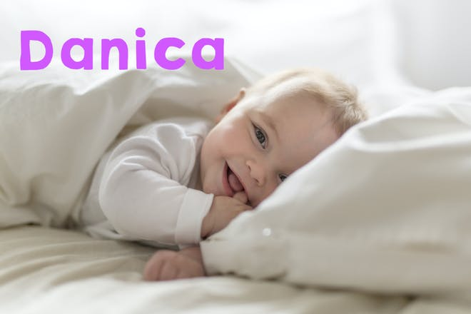 Baby laying in bed and smiling