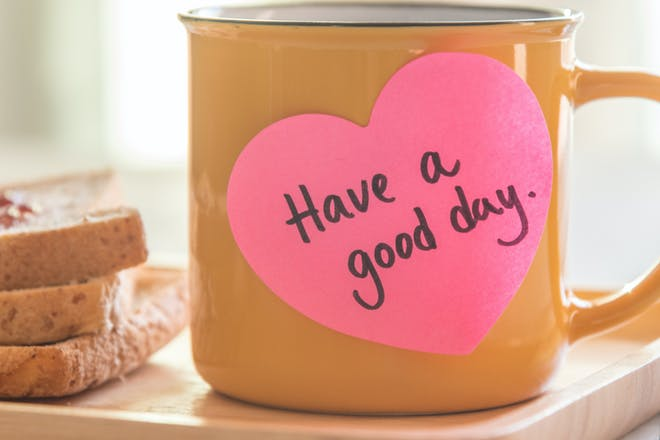 Mug of tea with 'Have a good day' post it