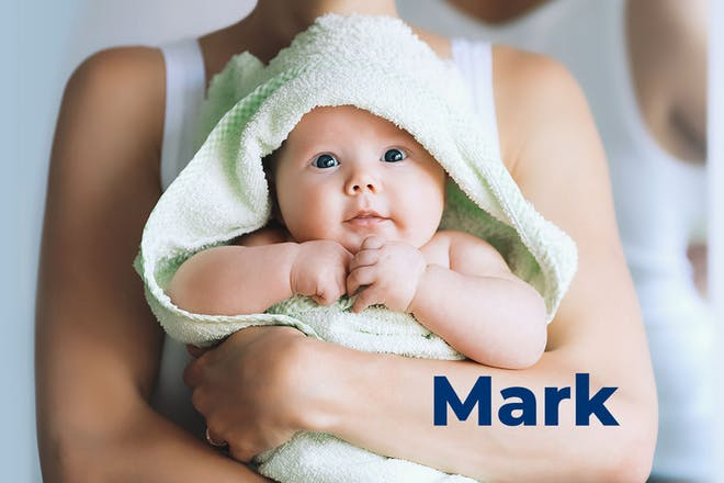 Baby wrapped in green towel being held by mum. Name Mark written in text