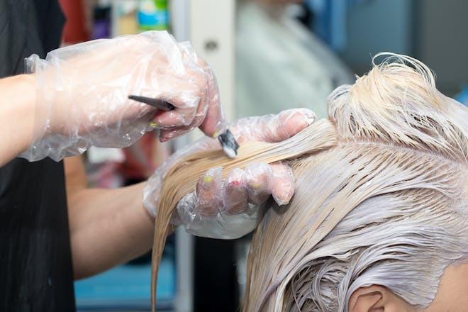 Woman having her hair bleached