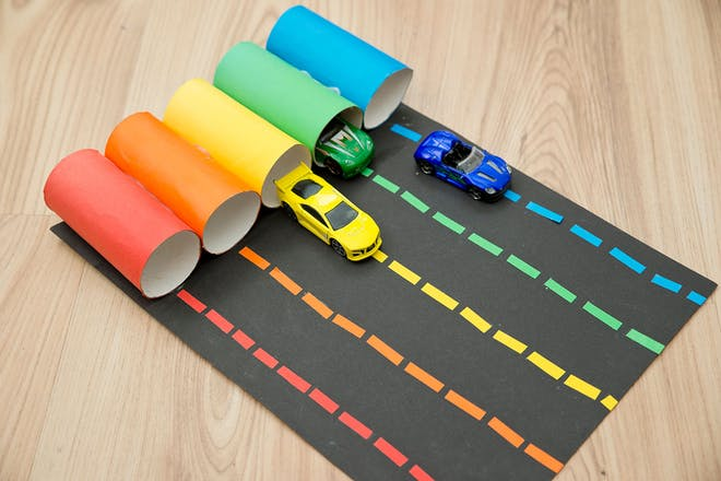 Coloured toilet rolls with the same colour toy cars inside them