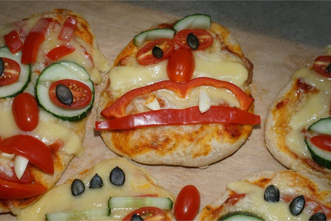 Pizzas decorated with scary faces for Halloween