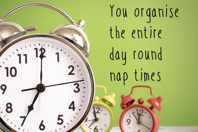 three alarm clocks on green background