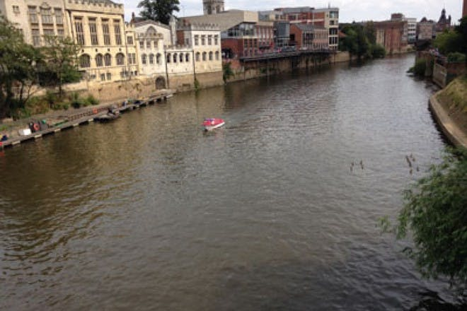 river in york with red boat on water
