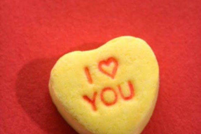 yellow candy heart on red background