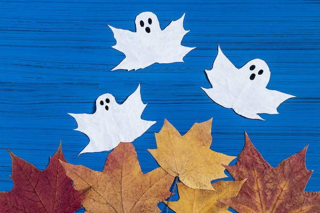 Maple leaves painted to look like ghosts for Halloween craft activity
