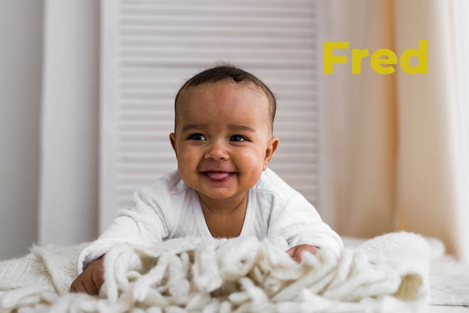 Baby smiling and trying to crawl. Name Fred written in text