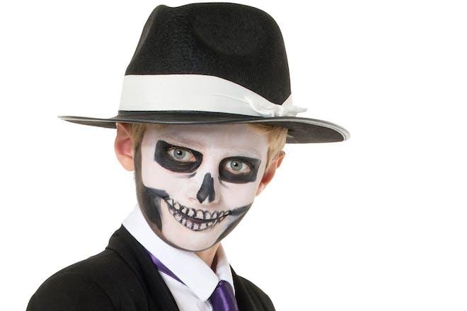 Boy dressed as Skulduggery Pleasant