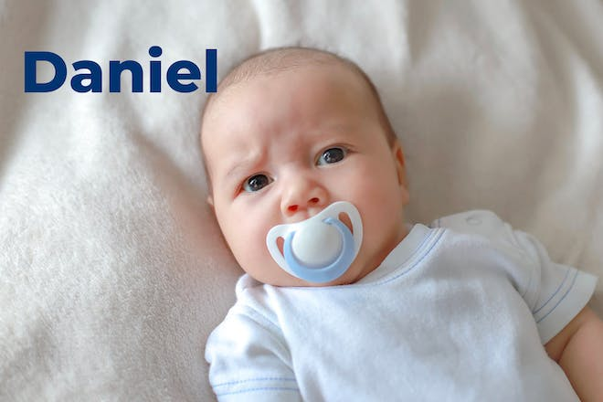 Baby with dummy and name Daniel written in text