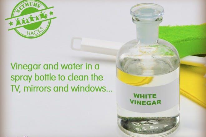 white vinegar in glass bottle with sponge