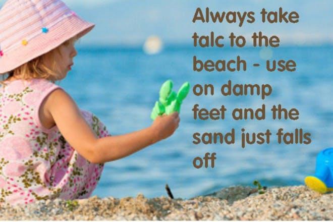 little girl playing on sandy beach