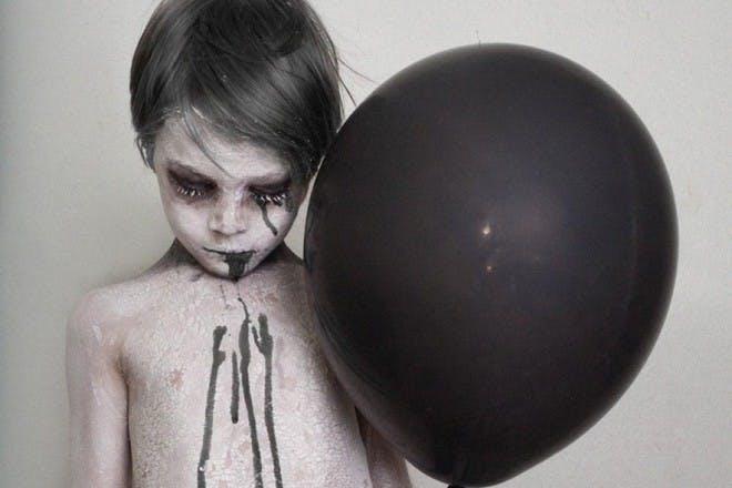 zombie boy with black balloon