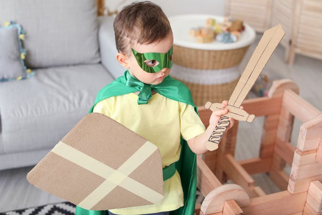 Little boy dressed as a knight