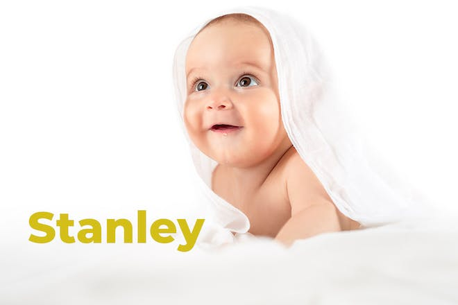 Baby with muslin. Name Stanley written in text