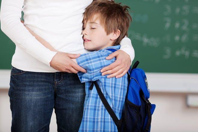 School boy hugging his mother