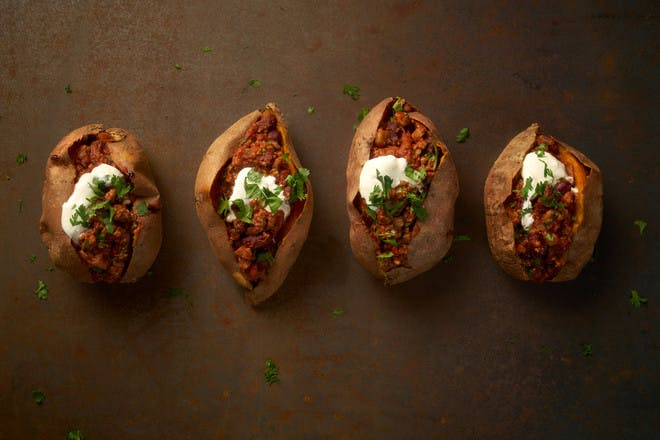 Baked sweet potatoes with Quorn chilli