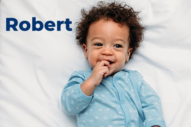 Baby wearing blue babygro. Name Robert written in text