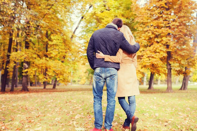man and woman hugging in park