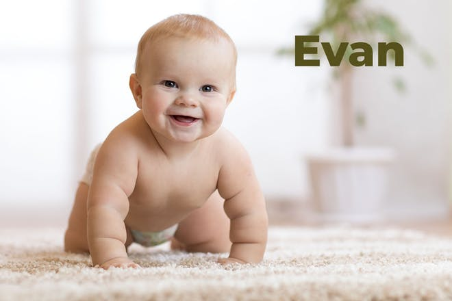 Baby crawling in nappy. Name Evan written in text